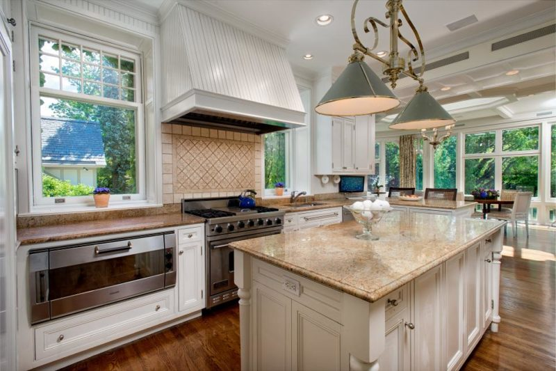 Cottage Kitchen With White Range Hood