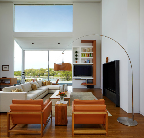Entertainment Center with White Walls and Tone Wood Flooring