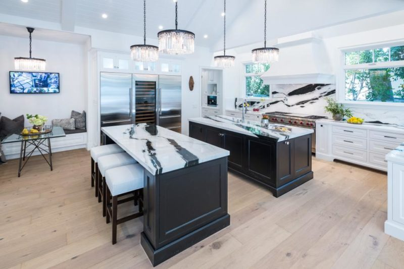 Extravagant White Kitchen With Eat-In Island and Prep Island
