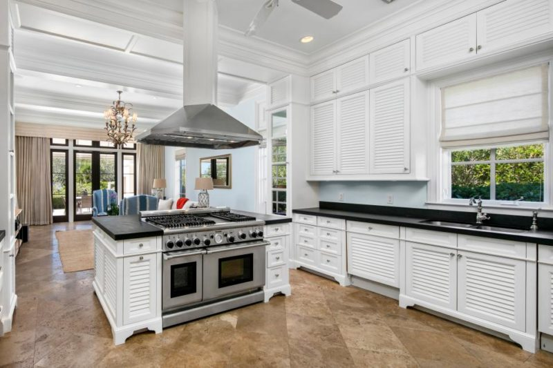 Luxury Chef's Kitchen With Double-Oven Island and White Cabinets