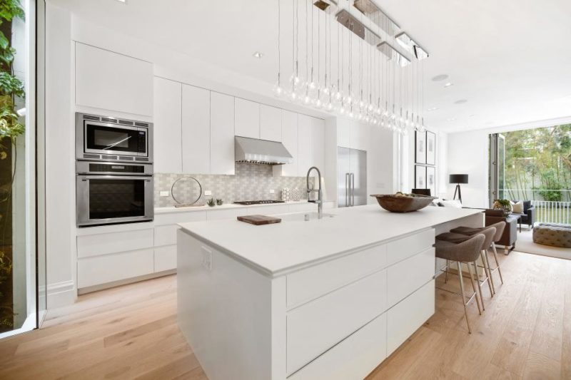 White Modern Kitchen With Oak Floors