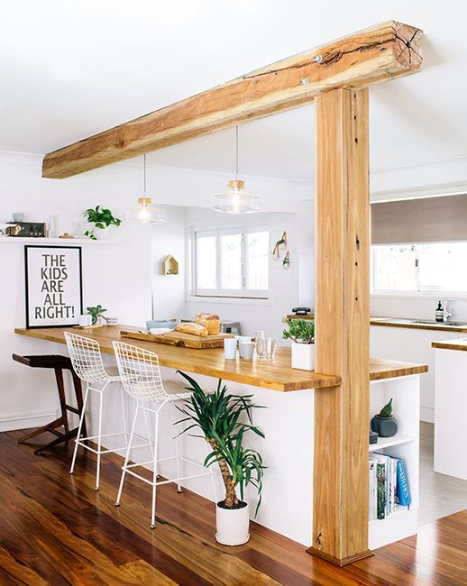 bohemian style kitchen island with wood beam