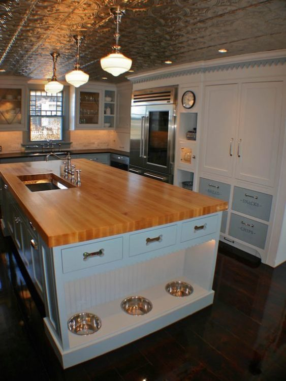 butcher's block kitchen island with pet feeding space