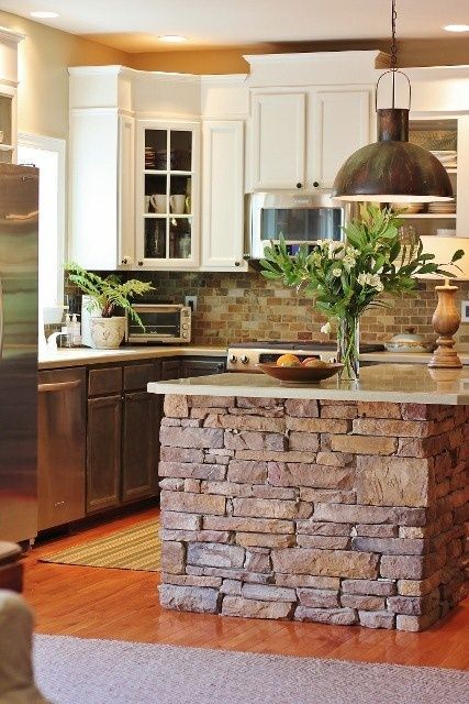 rustic kitchen island with brick backsplash