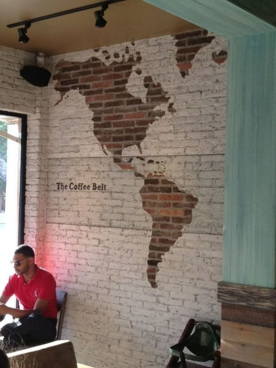 faux world map white brick wall