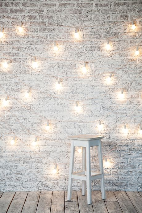 string light white brick wall