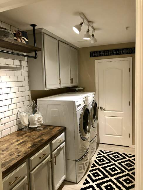 basement farmhouse laundry room with storage ideas